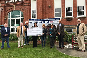 Buckhannon staff with President & CEO presenting a check to City of Buckhannon for Stockert Youth Center